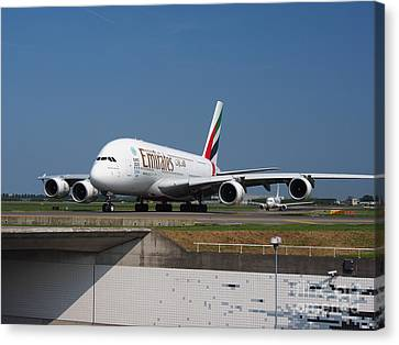 Emirates Airbus A380 Canvas Print by Paul Fearn
