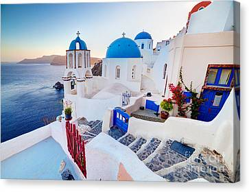 Oia Town On Santorini Greece Canvas Print by Michal Bednarek