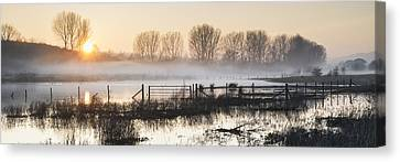 Panorama Landscape Of Lake In Mist With Sun Glow At Sunrise Canvas Print by Matthew Gibson