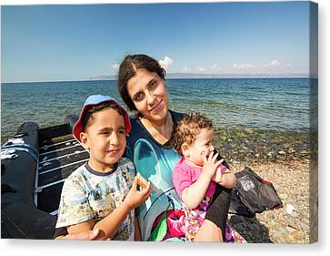 Syrian Refugees Arriving On Greek Island Canvas Print by Ashley Cooper