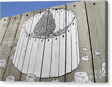 A Banksy Graffiti On The Separation Wall In Palestine Canvas Print by Roberto Morgenthaler