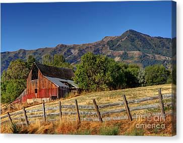 A Barn At Sunrise Beneath The Wellsville Mountains - Utah Canvas Print by Gary Whitton
