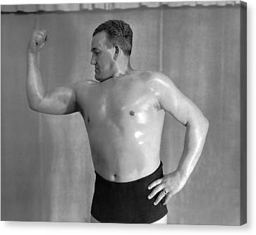 A Body Builder Poses Canvas Print by Underwood Archives