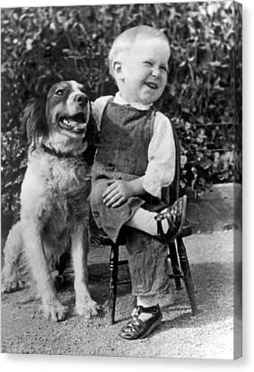 A Boy Laughs With His Dog Canvas Print by Underwood Archives