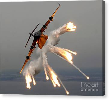 A C-17 Globemaster IIi Releases Flares Canvas Print by Stocktrek Images