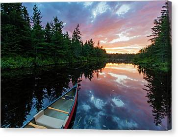 A Canoe At Sunrise On Little Berry Pond Canvas Print by Jerry and Marcy Monkman
