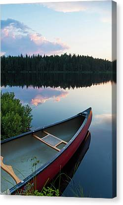 A Canoe On Little Berry Pond In Maine's Canvas Print by Jerry and Marcy Monkman