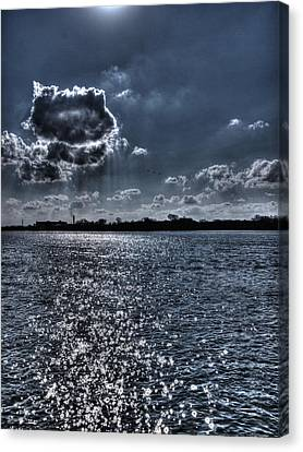 A Cloud Hanging Over The City Canvas Print by Thomas Young