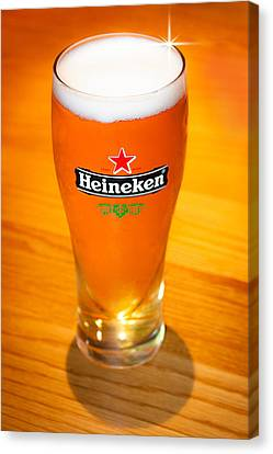 A Cold Refreshing Pint Of Heineken Lager Canvas Print by Semmick Photo