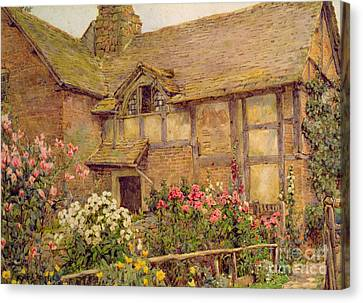 A Cottage Garden In Cholstry Canvas Print by Ernest Arthur Rowe