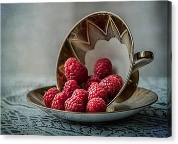 A Cupfull Of Raspberries Canvas Print by Maggie Terlecki