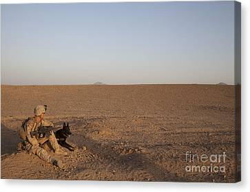 A Dog Handler With The U.s. Marine Canvas Print by Stocktrek Images