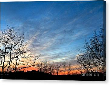 A February Sunset Canvas Print by Jay Nodianos