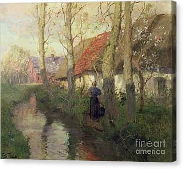 A French River Landscape With A Woman By Cottages Canvas Print by Fritz Thaulow