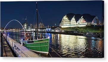 A Green Fishing Boat Moored Canvas Print by John Short