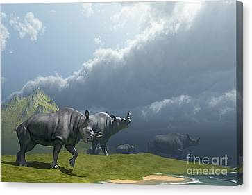 A Herd Of Brontotherium Dinosaurs Come Canvas Print by Corey Ford