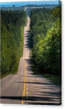 A Long Road Canvas Print by Matt Dobson