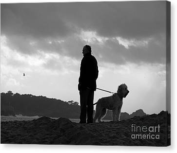 A Man A Dog And A Storm Canvas Print by James B Toy