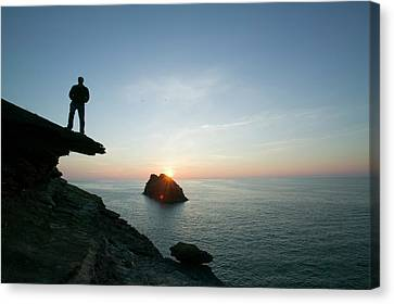 A Man On The Cliff Tops At Boscastle Canvas Print by Ashley Cooper