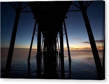 A Ocean Pier At Sunset In California Canvas Print by Peter Tellone