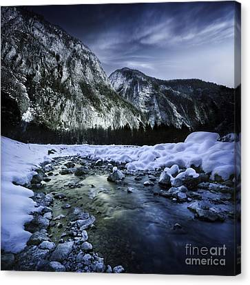 A River Flowing Through The Snowy Canvas Print by Evgeny Kuklev