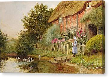 A Rustic Retreat Canvas Print by Arthur Claude Strachan