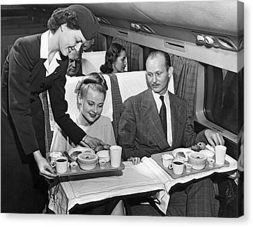 A Stewardess Serving Breakfast Canvas Print by Underwood Archives