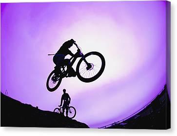 A Stunt Cyclist Silhouette Canvas Print by Corey Hochachka
