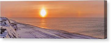 A Sundog Hangs In The Air Over The Canvas Print by Kevin Smith