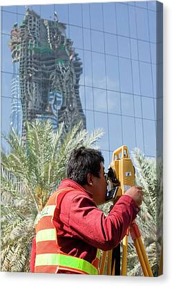 A Surveyor On A Construction Project Canvas Print by Ashley Cooper