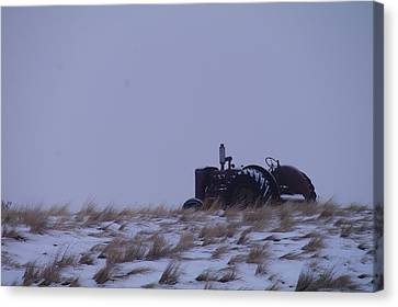 A Tractor Fading To The Snow  Canvas Print by Jeff Swan