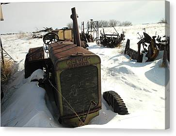 A Tractor In The Snow Canvas Print by Jeff Swan