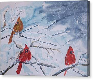 A Trio Of Cardinals Nestled In Snow Covered Branches Canvas Print by Ellen Levinson