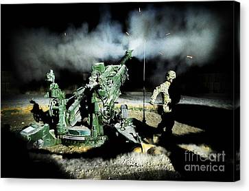 A United States Gun Crew Fire Illumination Rounds At Forward Operating Base Hadrian Canvas Print by Paul Fearn