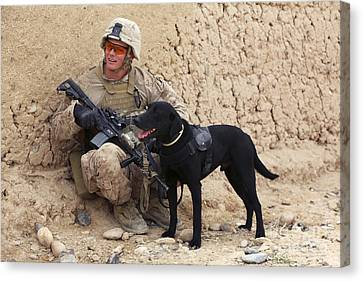 A U.s. Marine Dog Handler And His Dog Canvas Print by Stocktrek Images