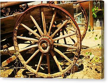 A Wagon Wheel Canvas Print by Jeff Swan