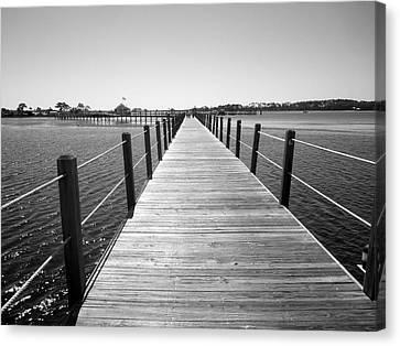 A Walk On The Pier Canvas Print by Adam Boettger