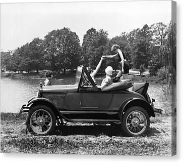 A Woman Exiting A Rumble Seat Canvas Print by Underwood Archives