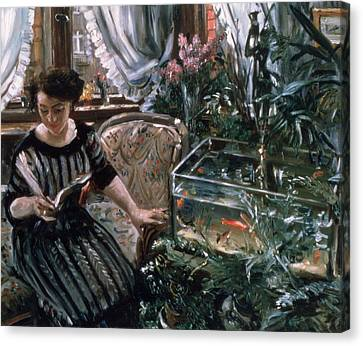 A Woman Reading Near A Goldfish Tank Canvas Print by Lovis Corinth