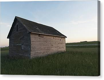 A Wooden Shed In The Middle Of A Grass Canvas Print by Keith Levit
