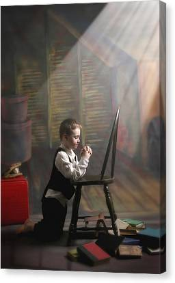 A Young Boy Praying With A Light Beam Canvas Print by Pete Stec