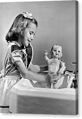 A Young Girl Plays With Her New All-vinyl Plastic Doll That Can Canvas Print by Underwood Archives