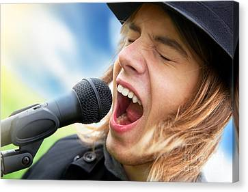 A Young Man Sings To A Microphone Canvas Print by Michal Bednarek