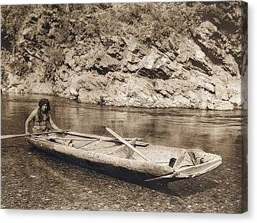 A Yurok In His Dugout Canoe Canvas Print by Underwood Archives