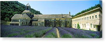 Abbey In A Lavender Field, Abbaye De Canvas Print by Panoramic Images