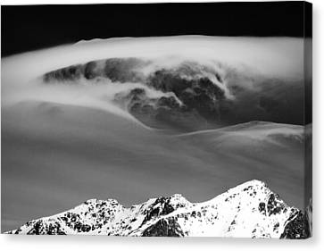 Above The Peaks Canvas Print by Dave Bowman