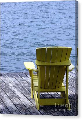 Adirondack Chair On Dock Canvas Print by Olivier Le Queinec