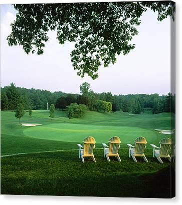 Adirondack Chairs In A Golf Course Canvas Print by Panoramic Images