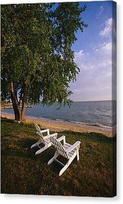 Adirondack Chairs Canvas Print by Panoramic Images