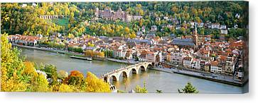 Aerial View Of A City At The Riverside Canvas Print by Panoramic Images